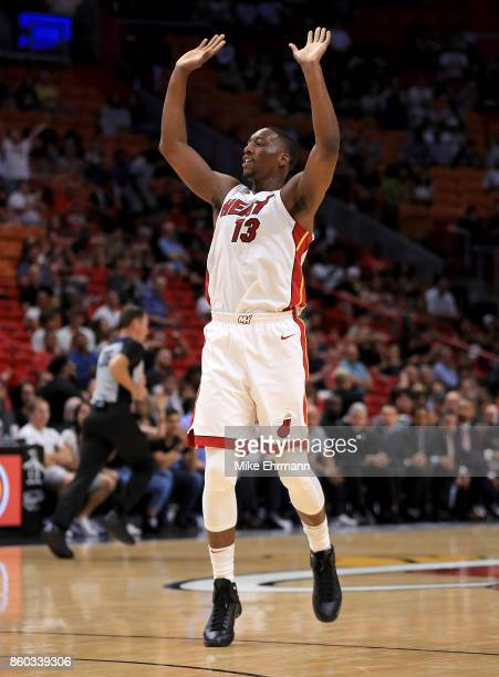 Bam Adebayo of the Miami Heat reacts to a dunk during a preseason game against the Washington Wizards at American Airlines Arena on October 11 2017...
