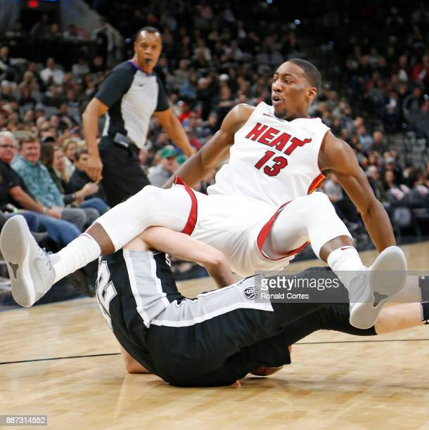 Bam Adebayo of the Miami Heat scrambles with Davis Bertans of the San Antonio Spurs for a loose ball at ATT Center on December 06 2017 in San Antonio...