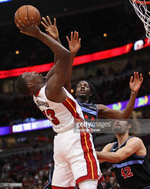 Bam Adebayo of the Miami Heat shoots against Justin Holiday of the Chicago Bulls at the United Center on November 23 2018 in Chicago Illinois NOTE TO...