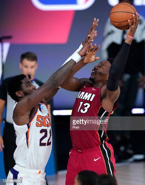 Bam Adebayo of the Miami Heat shoots the ball against Deandre Ayton of the Phoenix Suns during the second half of an NBA game at Visa Athletic Center...