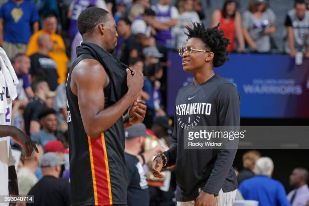 Bam Adebayo of the Miami Heat speaks with De'Aaron Fox of the Sacramento Kings after the game between the two teams during the 2018 Summer League at...