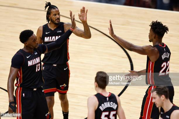 Bam Adebayo, Trevor Ariza and Jimmy Butler of the Miami Heat celebrate against the Chicago Bulls during the third quarter at American Airlines Arena...