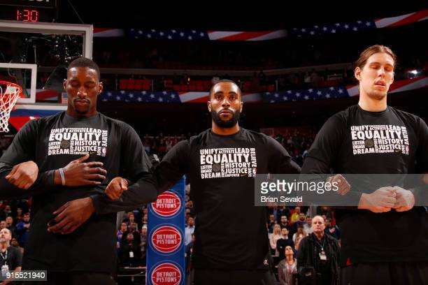 Bam Adebayo Wayne Ellington Kelly Olynyk of the Miami Heat stand for the national anthem prior to the game against the Detroit Pistons on February 3...