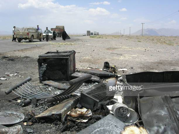 Remains of burnt cars are seen next to the BamKerman road where twelve Iranians were shot in cold blood on the side of a highway around 200...