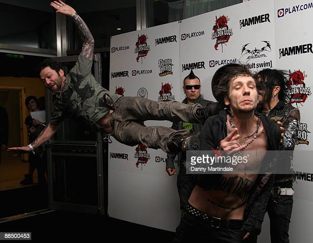 Bam Margera from Jackass fame kicks a member of the band The 69 Eyes during the Metal Hammer Golden Gods awards at Indigo2 at O2 Arena on June 15...