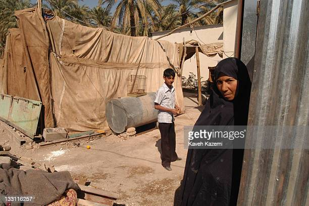 Bam residents camp in tents outside their ruined houses awaiting reconstruction almost a year after a major earthquake struck the city in Bam Iran...