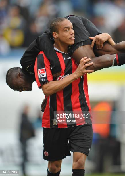 Bamba Anderson carries Constant Djakpa of Frankfurt in celebration at the end of the second Bundesliga match between Hansa Rostock the DKB Arena...