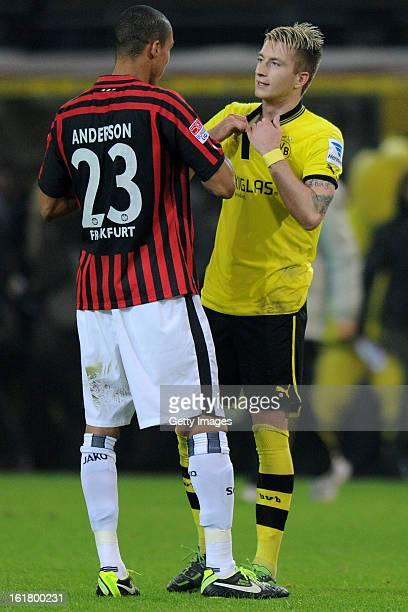 Bamba Anderson of Frankfurt and Marco Reus of Dortmund swap jerseys after the Bundesliga match between Borussia Dortmund and Eintracht Frankfurt at...