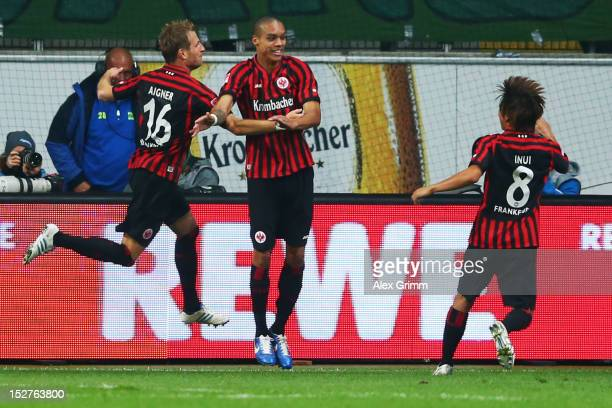 Bamba Anderson of Frankfurt celebrates his team's third goal with team mates Stefan Aigner and Takashi Inui during the Bundesliga match between...