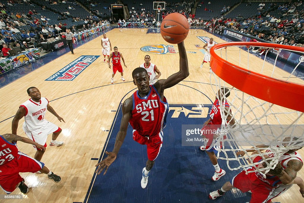 Bamba Fall #21 of the SMU Mustangs pulls down a rebound against the Houston Cougars during Round One of the Conference USA Basketball Tournament at FedExForum on March 11, 2009 in Memphis, Tennessee. Houston beat SMU