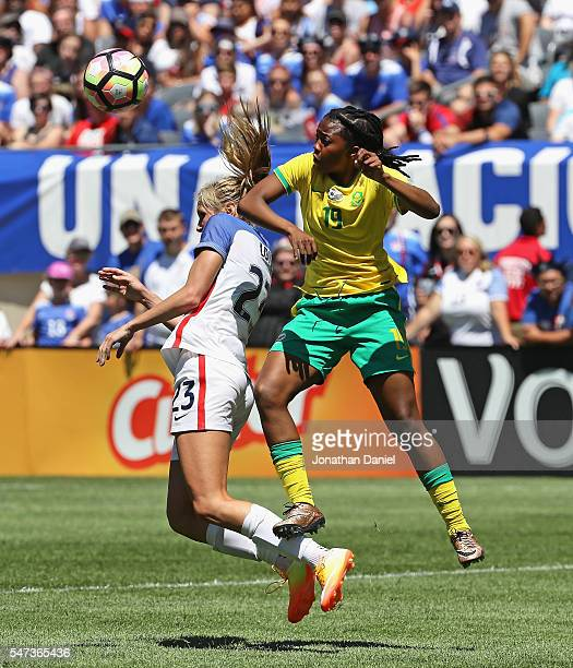 Bambanani Mbane of South Africa collides with Allie Long of the United States as they battle for the ball during a friendly match at Soldier Field on...