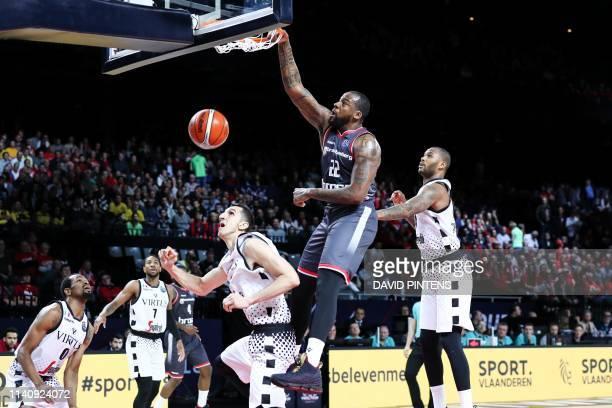 Bamberg's Cliff Alexander scores a dunk during a basketball match between German team Brose Bamberg and Italian Virtus Pallacanestro Bologna, the...