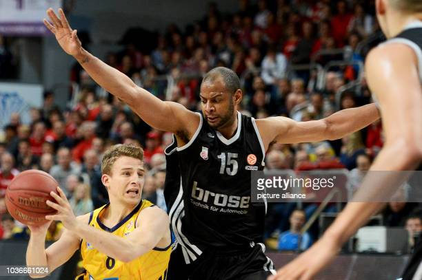 Bamberg's Sharrod Ford vies for the ball with Berlin's Heiko Schaffartzik during the Euroleague group E intermediate basketball round match between...