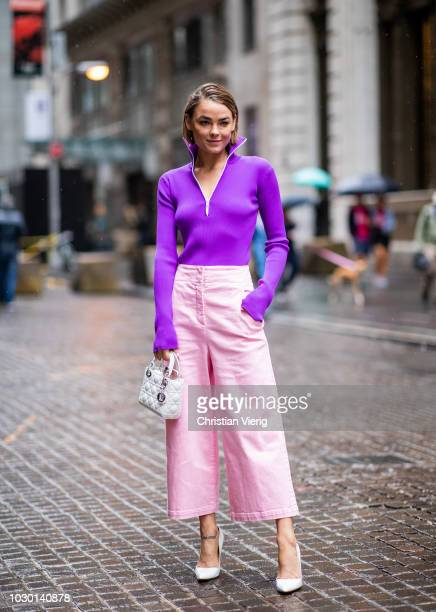 Bambi Northwood Blyth wearing pink cropped pants purple zipped jacket is seen outside Tibi during New York Fashion Week Spring/Summer 2019 on...