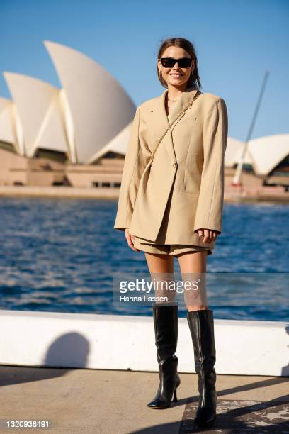 Bambi Northwood-Blyth wearing beige ANINE BING suit, knee high boots and sunglasses at Afterpay Australian Fashion Week 2021 on May 31, 2021 in...