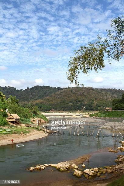 Bamboo bridge over a river in Luang Prabang in Laos