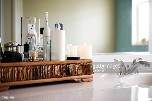 A bamboo caddy for beauty supplies next to a bathroom sink