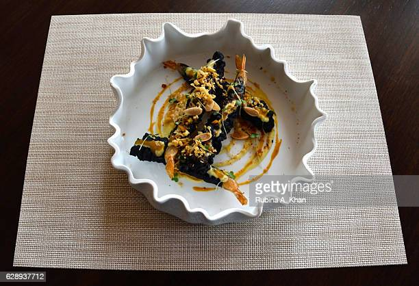 Bamboo Charcoal Prawn Tempura with Mango and Wasabi a signature dish created by W Goa's Director of Cuisine Chef Tanveer Kwatra for Spice Traders a...