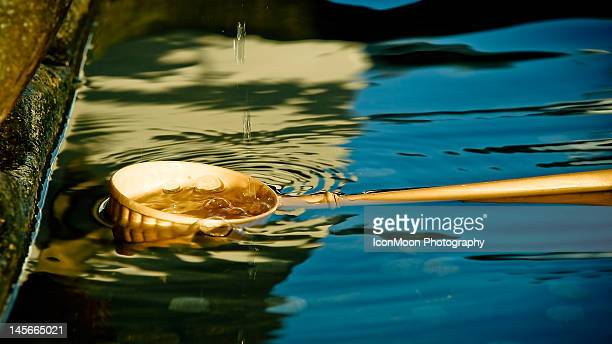 bamboo dipper in pool - bamboo dipper stock photos and pictures