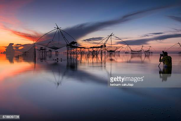 Bamboo fishing instrument in Songkhla lake at dawn.