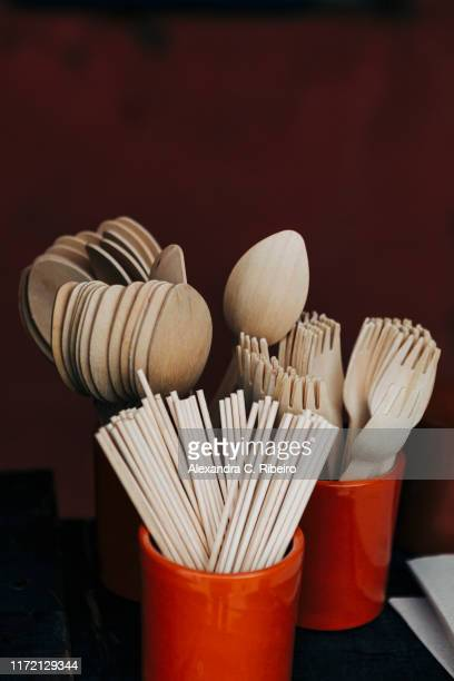bamboo fork, spoon and chopstick utensils in crocks - eating utensil stock pictures, royalty-free photos & images