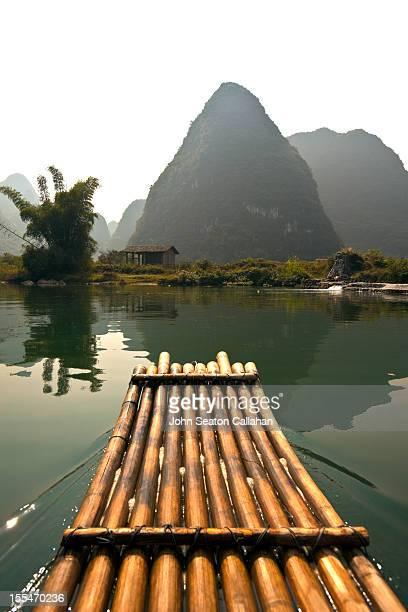 Bamboo raft and karst pinnacle, Yulong River.