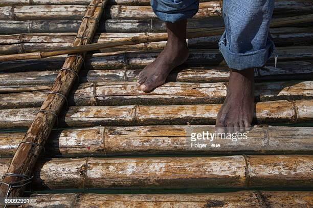 Bamboo raft captain's feet on Martha Brae river