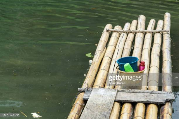 bamboo raft in royal belum rainforest park - existence for over 130 million years making it one of the world's oldest rainforest. - shaifulzamri stock-fotos und bilder