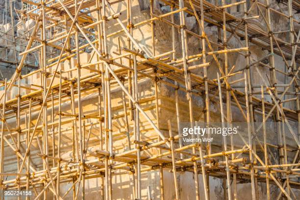 bamboo scaffolding, construction work, ananda pahto temple, bagan, mandalay region, myanmar - south east asia stock pictures, royalty-free photos & images
