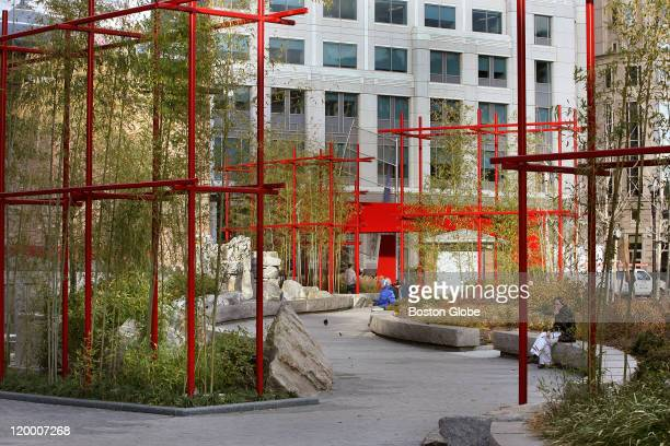 Bamboo shoots reach through red steel frames along the pedestrian path in Chinatown The Rose Fitzgerald Kennedy Greenway runs from Chinatown on its...