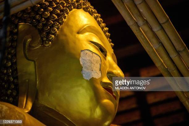 Bamboo stands are installed to repair a giant Buddha statue in Wat Pan Tao Buddhist temple in Chiang Mai on October 31, 2020.