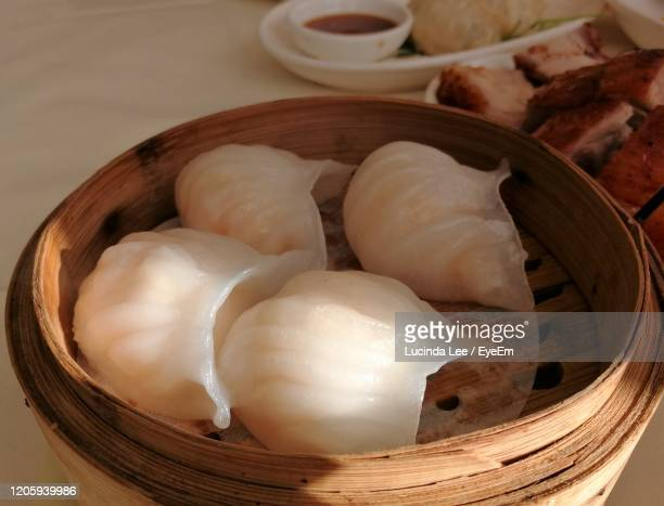 bamboo streamer containing dim sum dumplings - lucinda lee stock pictures, royalty-free photos & images