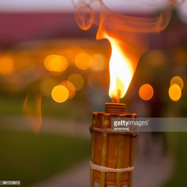 bamboo torch prepared for hari raya aidilfitri celebration - hari raya celebration stock pictures, royalty-free photos & images