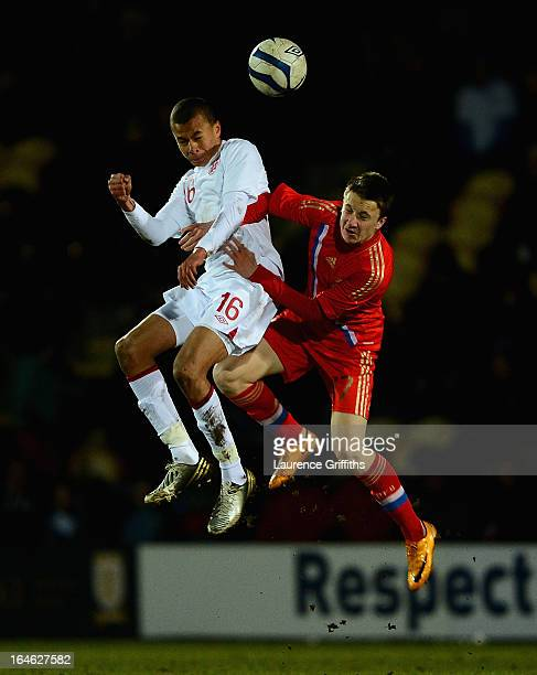Bamidele Alli of England battles with Alexandr Golovin of Russia during the UEFA European Under-17 Championship Elite Round match between England...