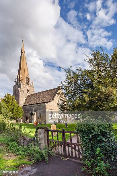 bampton church and gate - bampton stock pictures, royalty-free photos & images