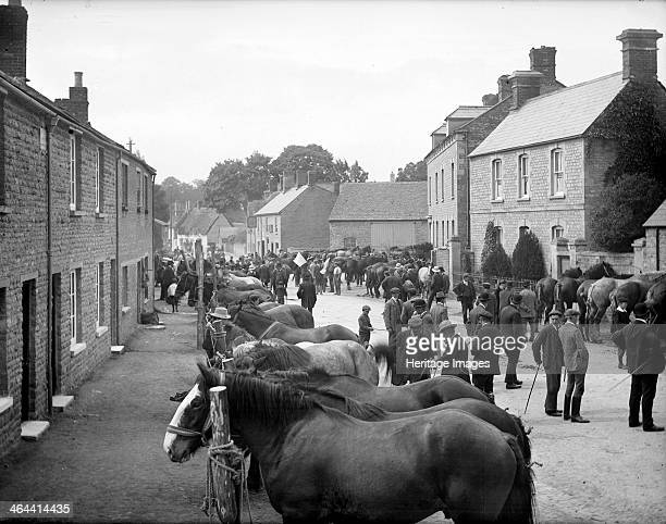 Bampton Horse Fair, Bampton, Oxfordshire, 1904. The street is crowded with horses and prospective buyers.