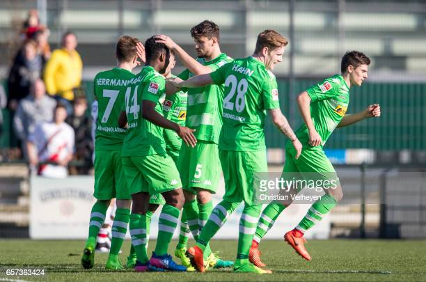 BaMuaka Simakala of Borussia Moenchengladbach celebrate with his team mates after he scores his teams first goal during the Friendly Match between...