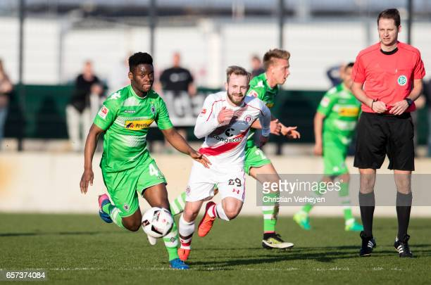 BaMuaka Simakala of Borussia Moenchengladbach is chased by JanMarc Schneider of FC St Pauli during the Friendly Match between Borussia...