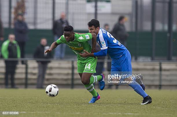 BaMuaka Simakala of Borussia Moenchengladbach is chased by Vangelis Pavlidis of VfL Bochum during the Friendly Match between Borussia...