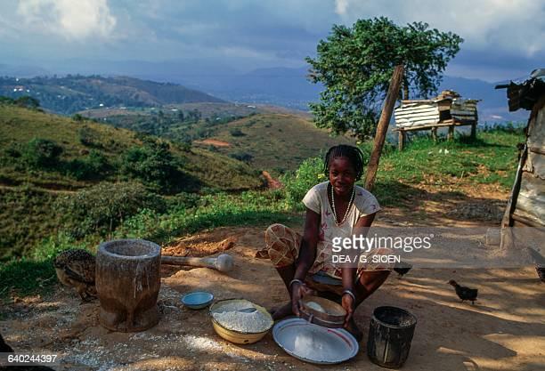 Bamun woman preparing couscous Bana Hill Cameroon