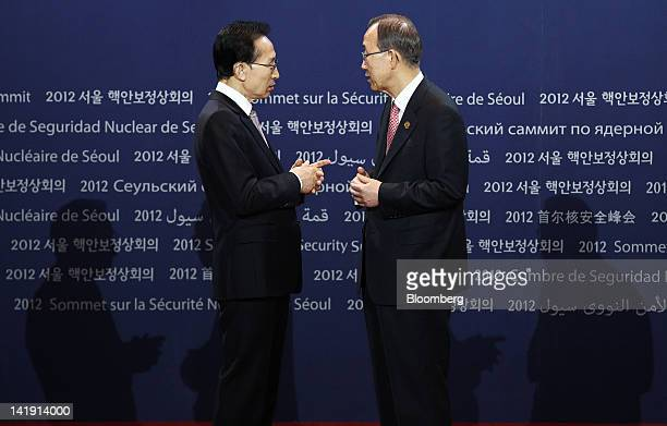 Ban Ki Moon, secretary-general of the United Nations, right, is welcomed by Lee Myung Bak, South Korea's president, during a photo session before the...