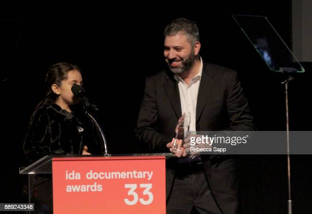 Bana alAbed and Evgeny Afineevsky accepts an award at the 33rd Annual IDA Documentary Awards at Paramount Theatre on December 9 2017 in Los Angeles...