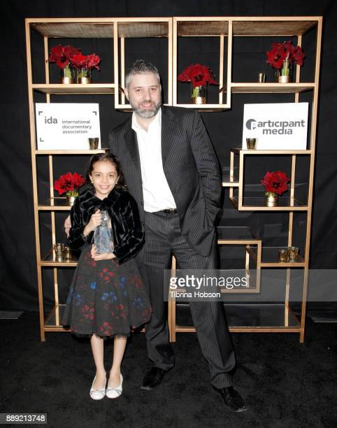 Bana alAbed and Evgeny Afineevsky pose with the Courage Under Fiere Award at the 33rd Annual IDA Documentary Awards at Paramount Theatre on December...