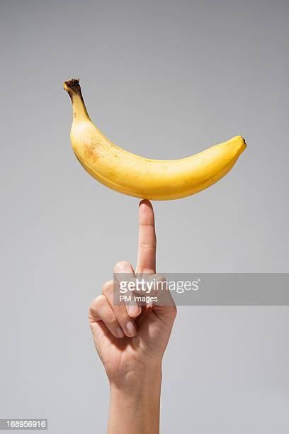 Banana balanced on finger