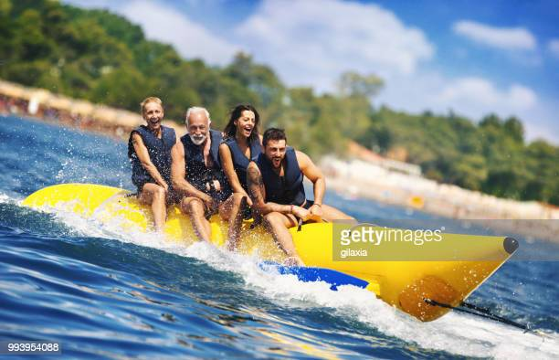 banana boat fun. - jet ski stock pictures, royalty-free photos & images