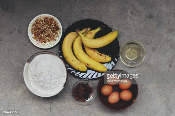 Banana bread ingredients on gray surface