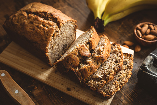Banana Bread Loaf On Wooden Table 1147312072