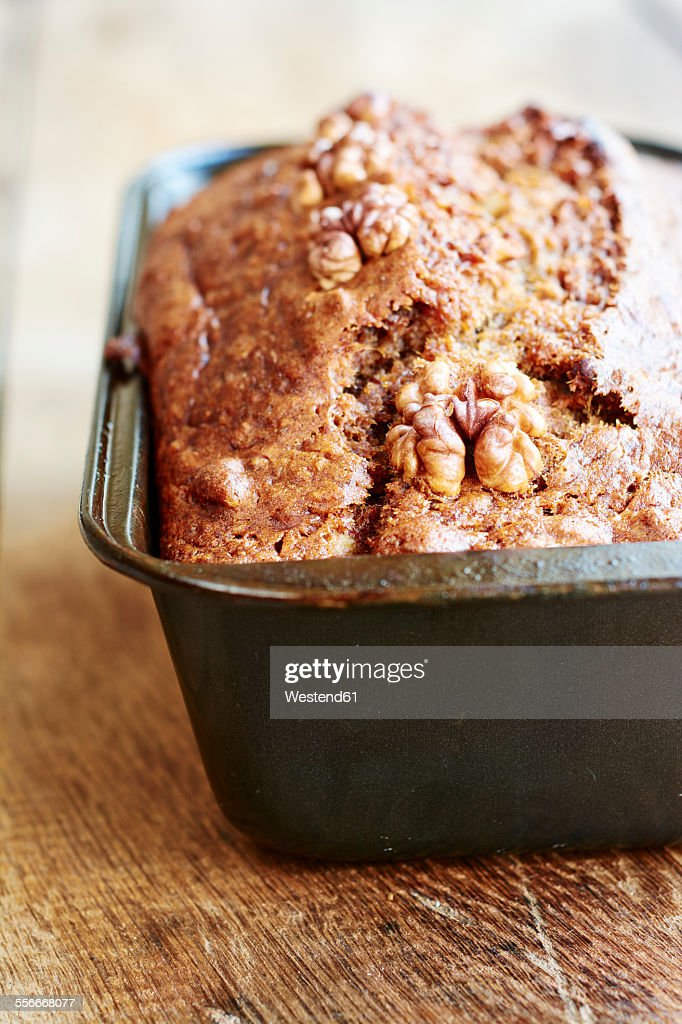 Banana bread with walnuts in a bread pan : Stock Photo