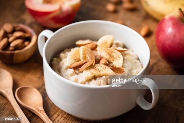 banana cinnamon oatmeal porridge bowl - oats food stock pictures, royalty-free photos & images