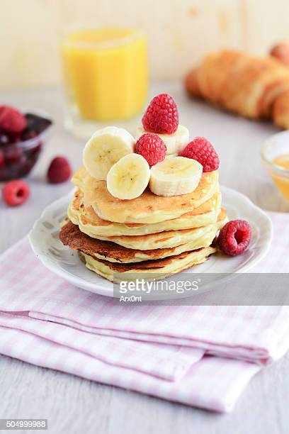 Banana coconut pancakes with fruits and berries